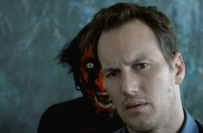 The Lipstick-Face Demon that haunts the Lambert house lingers over the shoulder of the family's patriarch, Josh Lambert (Patrick Wilson).