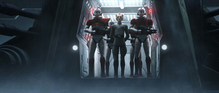 Grand Moff Tarking standing aboard a starship with two clone troopers beside him.