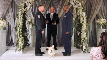 Holt, Kevin, and Cheddar the dog on the altar