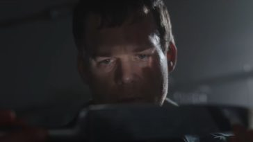 Dexter sees his reflection in a butcher knife the light of which shows over his eyes.