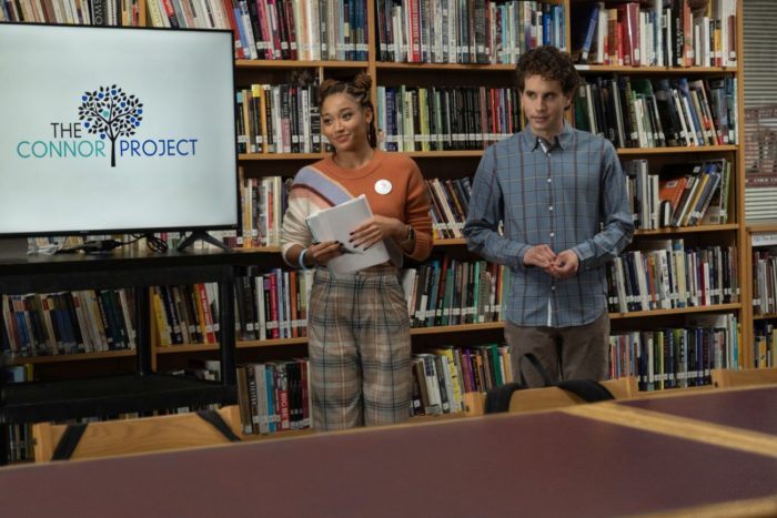 Two students are leading a presentation in a library