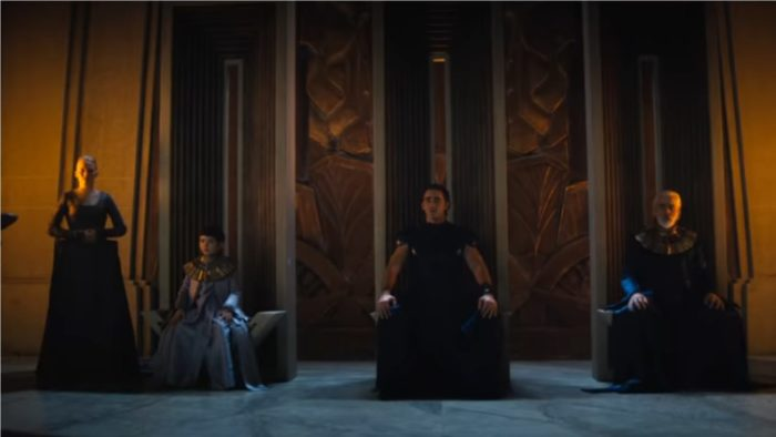 Foundation S1E1 - Brother Dawn, Day and Dusk sit upon their thrones with Demerzel standing behind Dawn