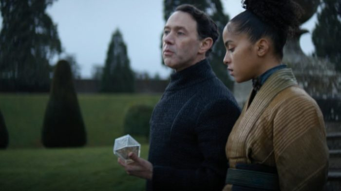 Foundation S1E1 - Jerril and Gaal are walking through a well-groomed garden, Jerril holding the Prime Radiant in his hand