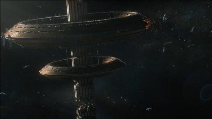 Foundation S1E1 - The tops of the Star Bridge drifts with debris floating around it