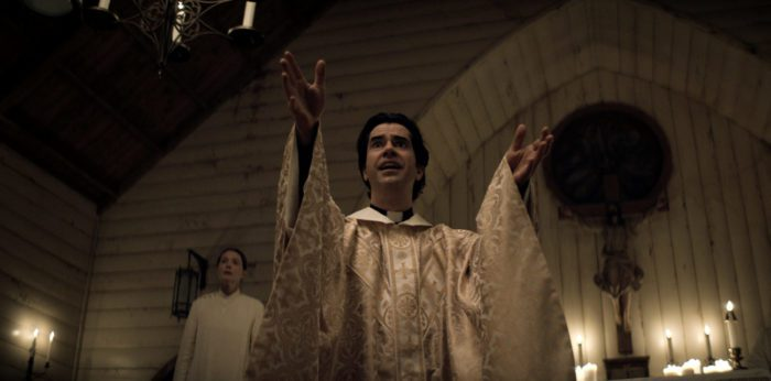 Father Paul (Hamish Linklater) preaches.