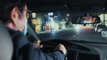 Josh behind the wheel of his car wearing a mask, seen as if from the backseat in Mr. Corman S1E9