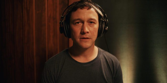 Josh wears headphones and looks forward, semi-breathless, at the end of Mr. Corman S1E10