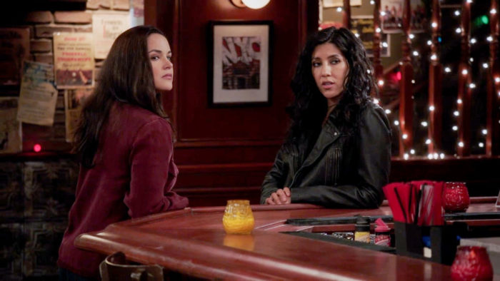 Amy and Rosa sit at the bar