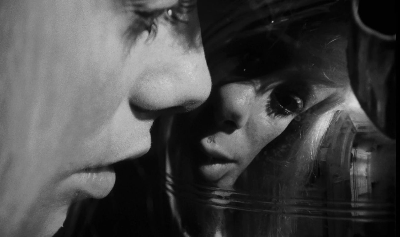 In this image from Repulsion, Carol (Catherine Deneuve) is depicted in close-up inspecting a distorted image of herself in an urn.