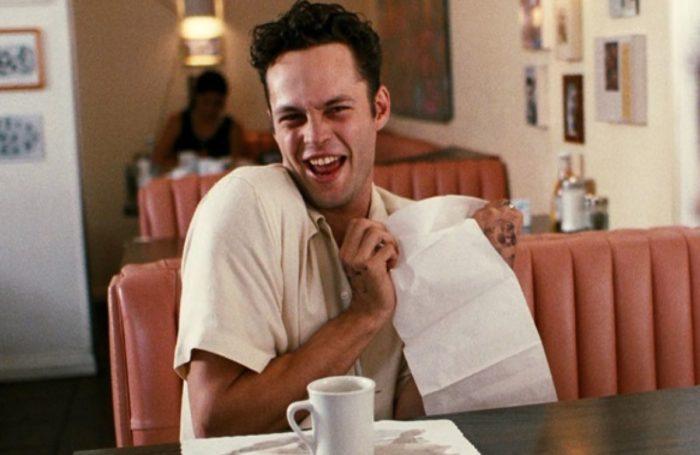 Trent pretends to use his napkin to play peekaboo.