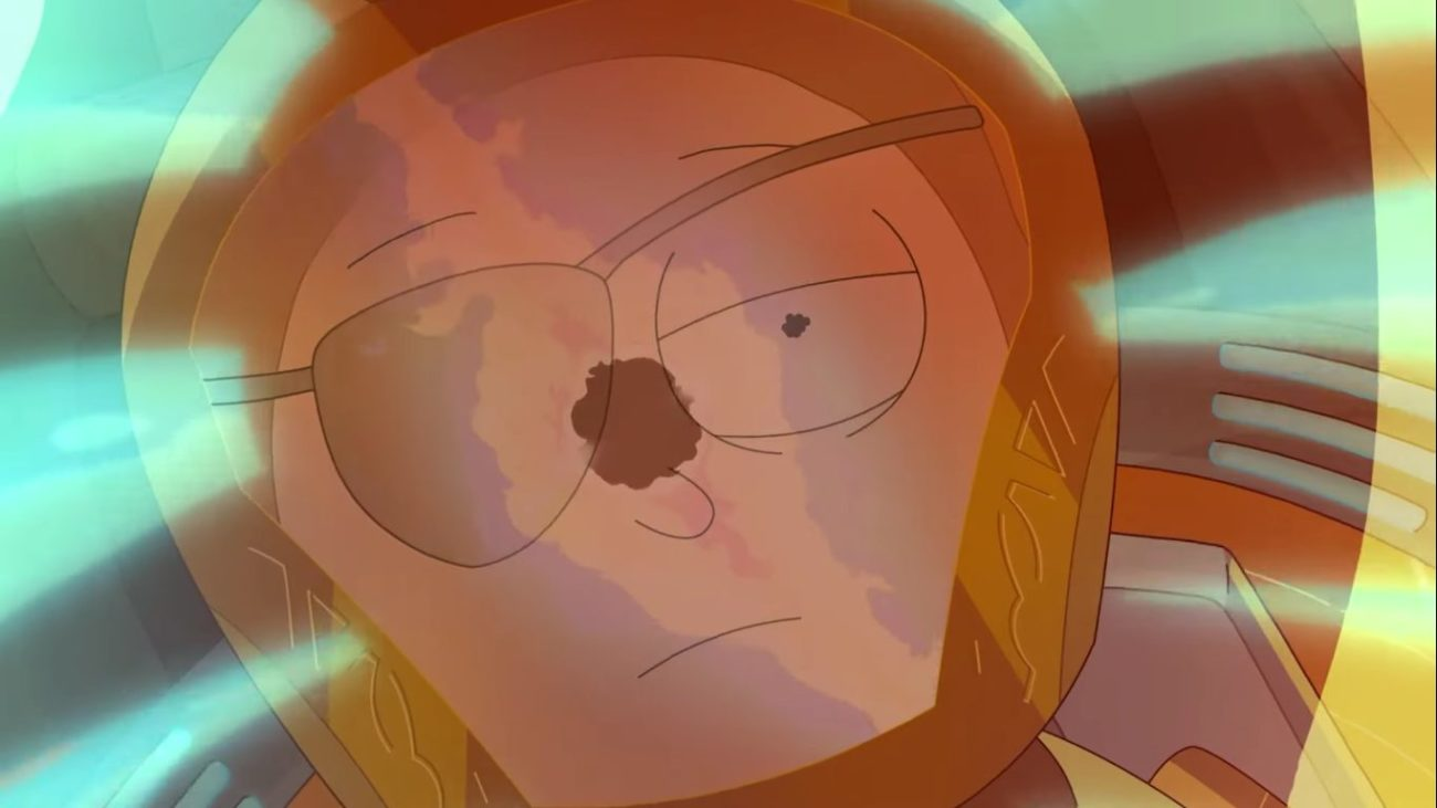 Wearing his iconic eye patch, Evil Morty gazes at an explosion that is reflected in his spaceship window