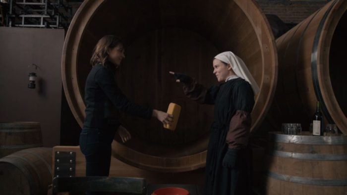 Fenna playfully points at Kristen in front of an empty wine barrel.