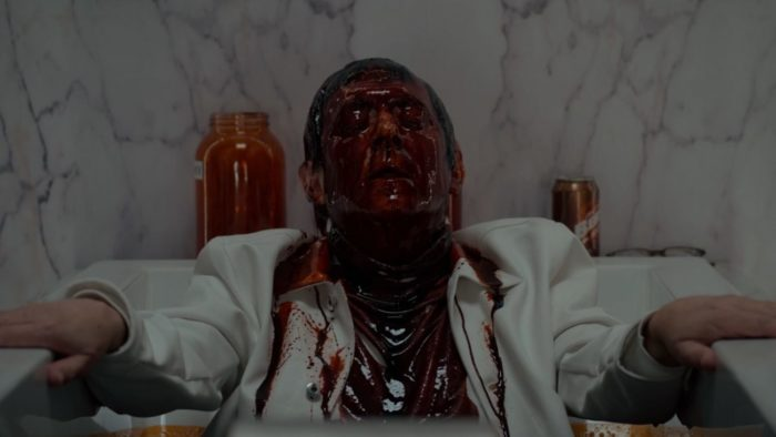 Leland is in a bathroom, covered in blood.