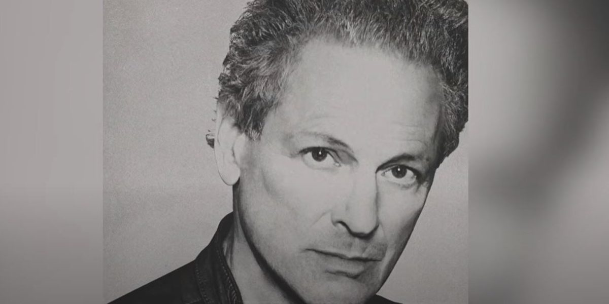 Lindsey Buckingham with his head slightly tilted in grey on the cover of his self-titled album