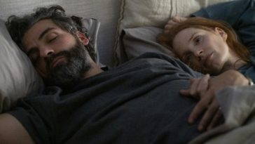 Jonathan (Oscar Isaac) and Mira (Jessica Chastain) are depicted in bed, he with eyes closed, she with them open, in this image from Hagai Levi's Scenes from a Children.