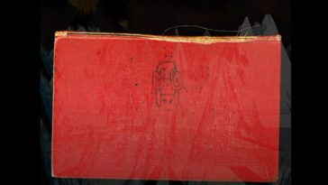 The red cover of Amnesiac with a poorly drawn figure on it beginning to fade out as the mountain like image from the cover of Kid A fades in