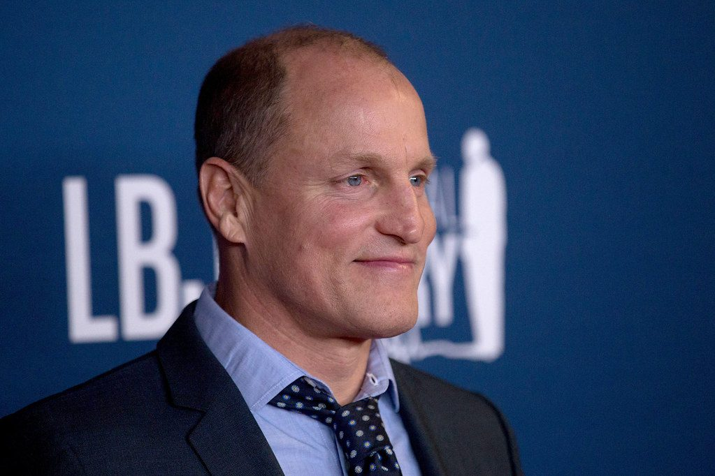 Woody Harrelson appears on a red carpet for photographs