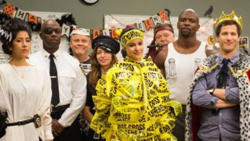 The B99 squad in Halloween costumes: from left to right, Rosa, Holt, Hitchcock, Gina, Amy, Scully, Terry, and Jake