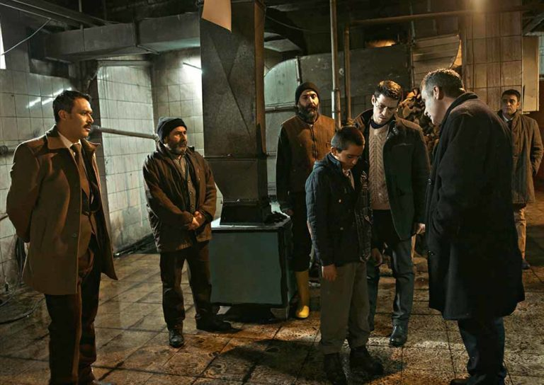 Teachers surround Yusuf in the boiler room, hearing his confession