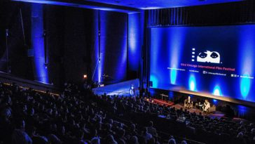 A crowded theater hosts a special event at the Chicago International Film Festival