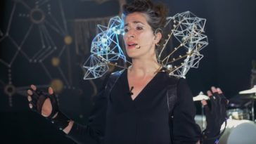 Imogen Heap sings and performs with her Mi.Mu gloves.
