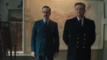 Matthew Macfadyen stands beside Colin Firth in front of a map in Operation Mincemeat