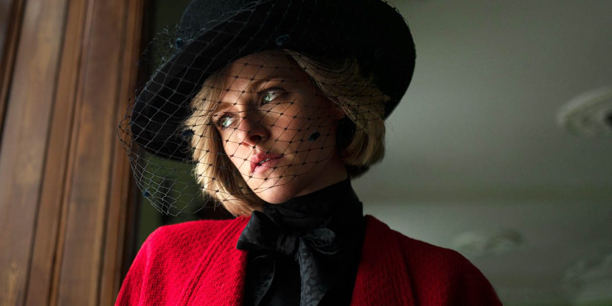 Diana Spencer looks out the window through a veiled hat.