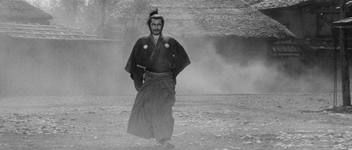 Toshiro Mifune as Sanjuro steps out of the fog in Kurosawa's 'Yojimbo.' The iconic shot is the inspiration for the still from 'The Duel' pictured above.