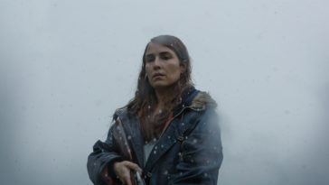 Noomi Rapace standing with a shotgun in Lamb