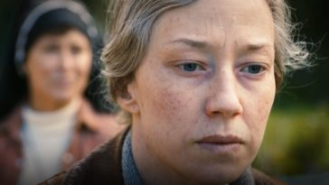 """An older Nora looks on wearily, with a nun behind her slightly out of focus in """"The Book of Nora"""""""