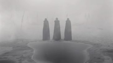 The three witches standing in the fog