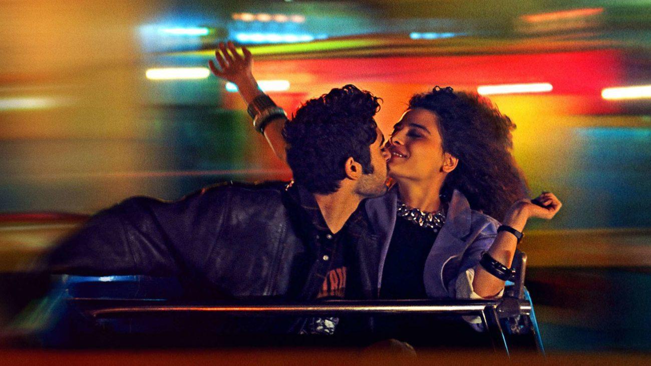 Memory Box (dirs. Joana Hadjithomas & Khalil Joreige, 2021) - post image, a man and a woman spinning romantically on a rollercoaster ride